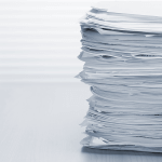 Image of a stack of paper fax documents